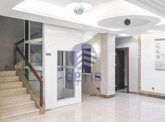 Bước tiến công nghệ với thang máy gia đình cửa mở tay